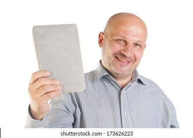 Businessman holding a book. Isolated over white background.