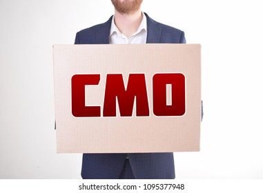 The businessman is holding a box with the inscription:CMO