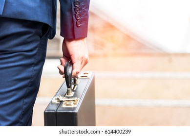 businessman holding briefcase and going to work time