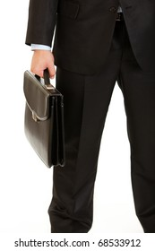 Businessman holding briefcase in hand isolated on white. Close-up.