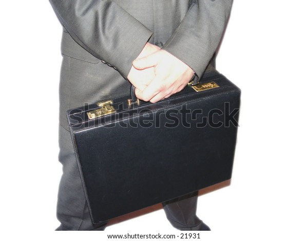 Businessman holding a briefcase in his hands isolated white backgrounds