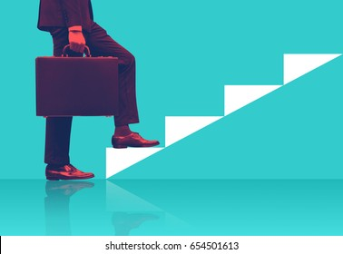 Businessman holding briefcase walking on graphic stair, start up business concepts.