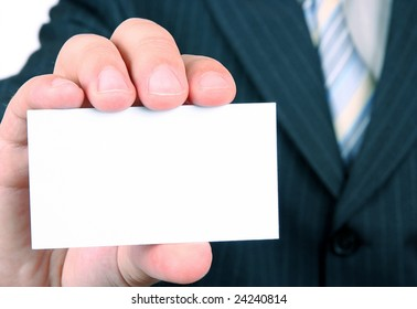 businessman is holding a business card