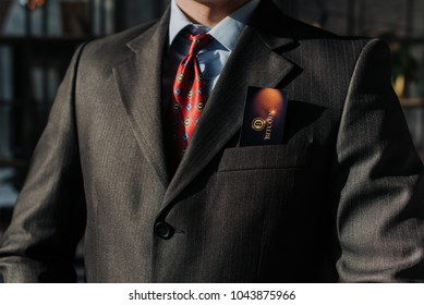 Businessman holding business card with Bitcoin text. Selective focus on card and fingers.Time is money, income growth, return on investment, business and finance management