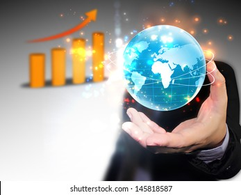 businessman holding business world