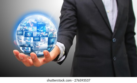 Businessman holding business world.