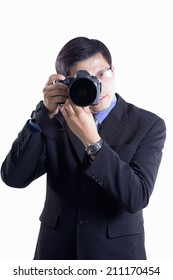 Businessman holding a camera on white background.
