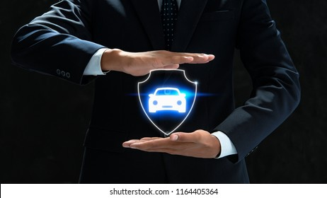 businessman holding car icon.Car Care and maintenance concept.