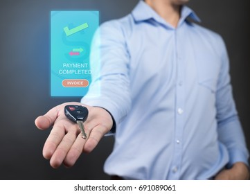 Businessman holding car key with  Success payment visual graphic. Online payment concept