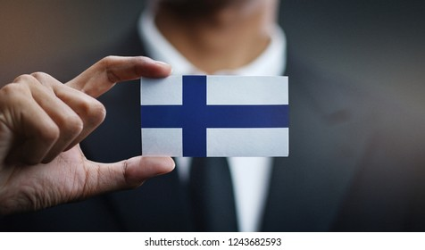 Businessman Holding Card of Finland Flag