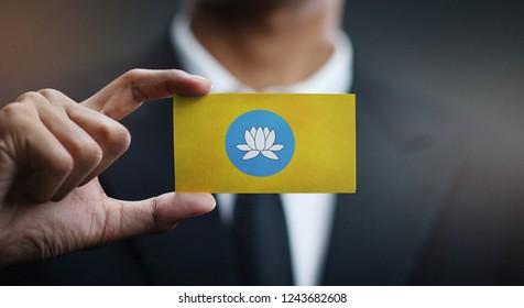 Businessman Holding Card of Kalmykia Flag