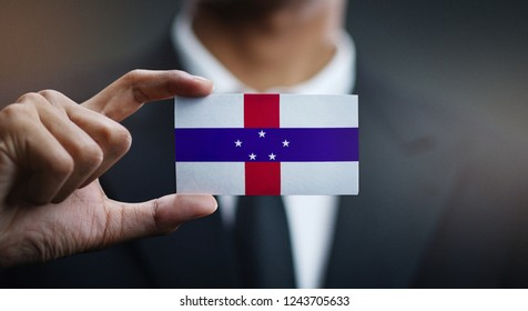 Businessman Holding Card of Netherlands Antilles Flag