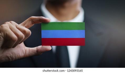 Businessman Holding Card of Republic of Dagestan Flag