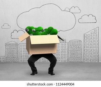 Businessman holding cardboard box with green grass lightbulbs inside, on clouds city buildings doodles of concrete wall background, concept of ECO and green energy.