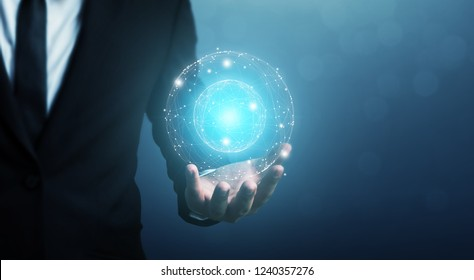 Businessman holding circle global network system connection and big data exchanges worldwide with bokeh background. Business networking communication and technology concept
