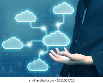businessman holding cloud network