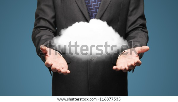 businessman holding cloud  on a blue background