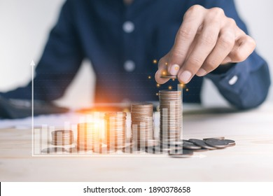 businessman holding coins putting in glass. concept saving money for finance accounting to arrange coins into growing graphs concept.