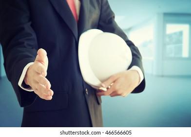 Businessman holding construction helmet