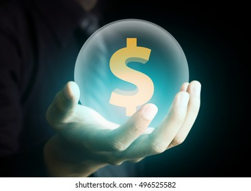 businessman holding crystal ball with dollar sign