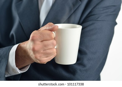 Businessman holding a cup of tea isolated on white