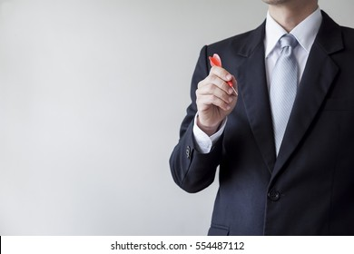 Businessman holding a dart  - business targeting, aiming, focus concept.
