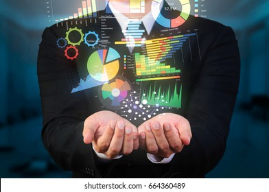 businessman holding data visualization