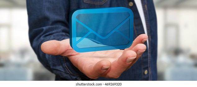 Businessman holding a digital 3D email icon in his hand 3D rendering