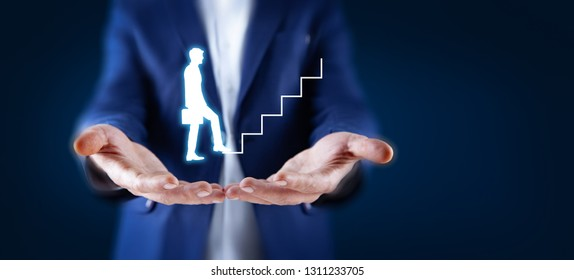 Businessman holding digital glowing graph