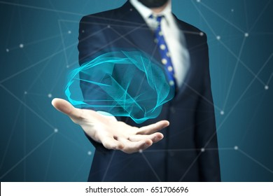 Businessman holding digital human brain