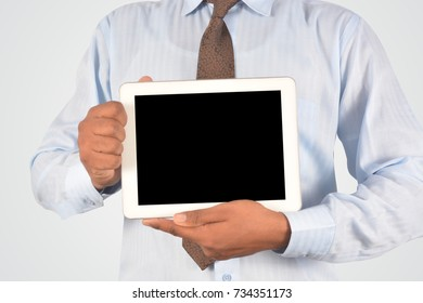 Businessman holding digital tablet pc, isolated very professionally