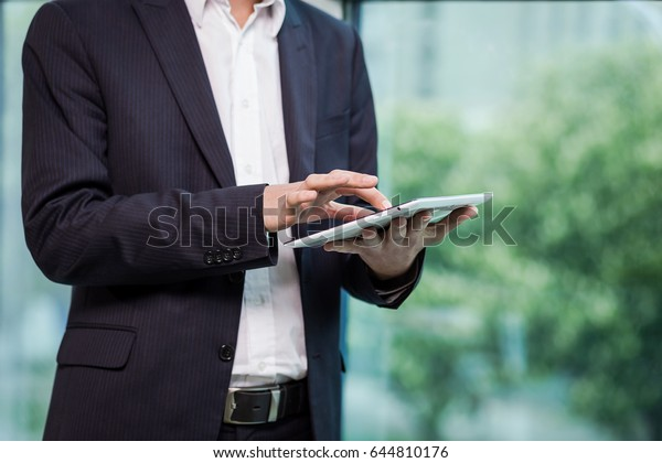 businessman holding a digital tablet working in the office