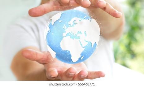 Businessman holding digital tactile world in his hand â??3D renderingâ??