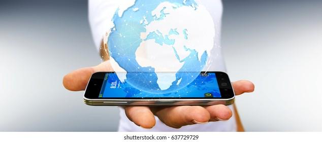Businessman holding digital tactile world over mobile phone 3D rendering