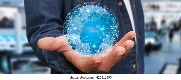 Businessman holding digital web earth with connection lines '3D rendering'
