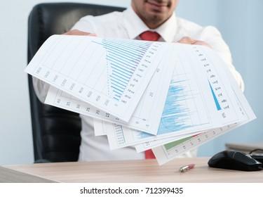 Businessman holding documents, closeup shot