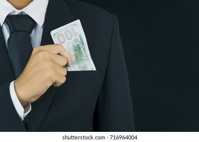 businessman holding dollar banknote