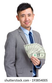 Businessman holding dollar bills