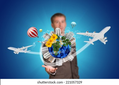 Businessman holding earth with buildings. Element of this image furnished by NASA
