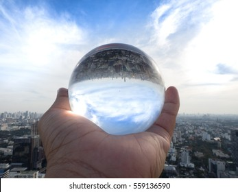 Businessman holding earth in crystal ball