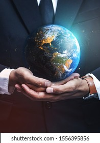 Businessman Holding Earth. Save Earth Concept. Elements of this image furnished by NASA