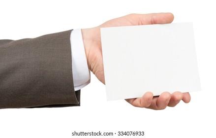 Businessman holding empty sheet on isolated white background