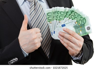 Businessman holding a lot of euros money and showing thumbs up sign