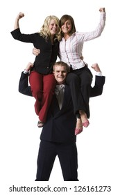 Businessman holding female colleagues on shoulders