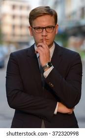 Businessman holding finger on lips