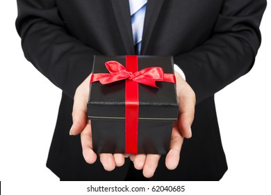 businessman holding a gift package in hand