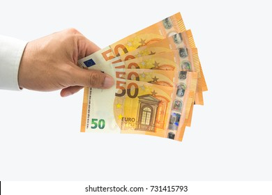 Businessman holding or giving euro money bills in hand isolated on white background with clipping path. Investment, financial , donation and successful in business concept.