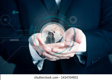 Businessman holding a glass planet. Global business background concept close up