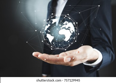 Businessman holding global network and data exchanges over the world