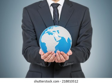 Businessman is holding globe, Africa and Asia view. Elements of this image furnished by NASA
